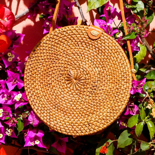 Rattan round bag and colourful flowers